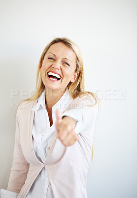Buy stock photo Portrait of an excited casual businesswoman gesturing goodluck sign against grey background