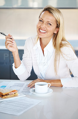 Buy stock photo Portrait of a charming young businesswoman working on the contract paper at office