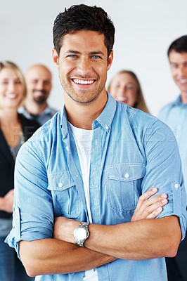Buy stock photo Smart casual businesssman standing with his hands folded with oher business colleagues