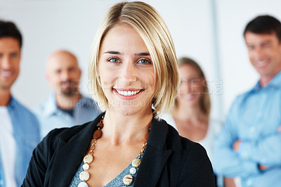 Buy stock photo Portrait of a beautiful young business woman smiling with colleague standing in background