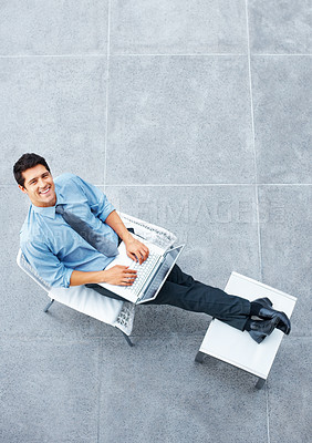 Buy stock photo Top view of businessman sitting in chair, working on laptop