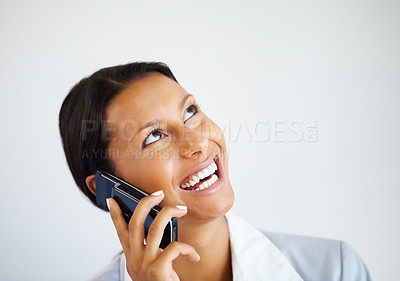 Buy stock photo Female executive on cell phone, looking up