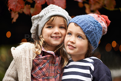 Buy stock photo Portrait of a cute brother and sister standing outdoors on an autumn day