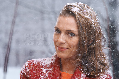 Buy stock photo Shot of an attractive woman enjoying herself outside in the snow