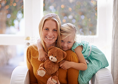 Buy stock photo Cropped portrait of a little girl sitting with her mother and her teddybear
