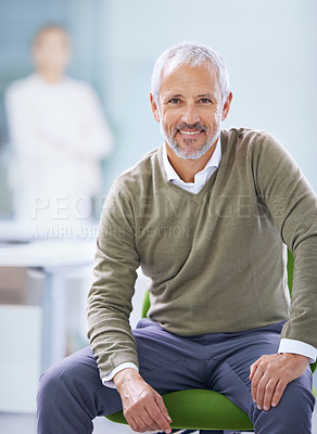 Buy stock photo Portrait of a mature businessman sitting on his office chair