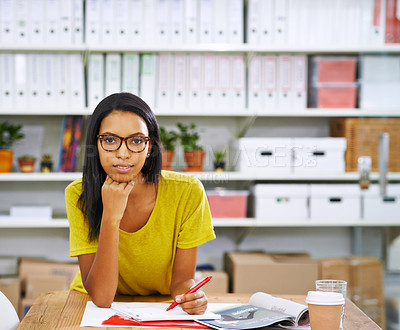 Buy stock photo Shot of an attractive young designer working in an office