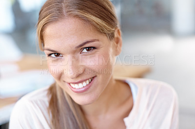 Buy stock photo Portrait of an attractive young business professional smiling at the camera