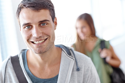 Buy stock photo Closeup portrait of two young university students standing in hallway