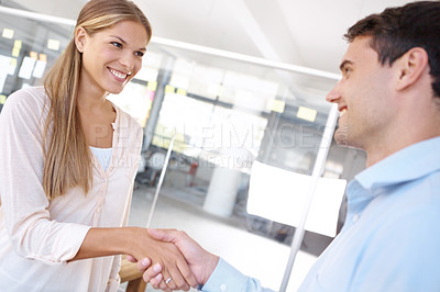 Buy stock photo Two businesspeople shaking hands in an office - copyspace