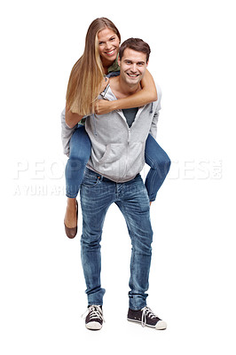 Buy stock photo Happy young boyfriend giving his girlfriend a piggyback ride