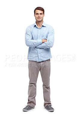 Buy stock photo Handsome young man standing with his arms folded and smiling at the camera - isolated