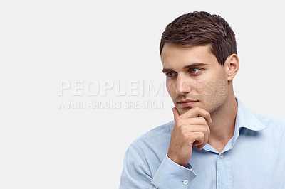 Buy stock photo Handsome young man looking pensively sideways
