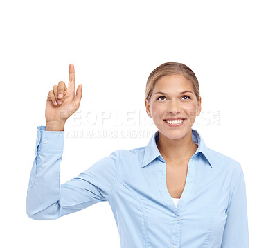Buy stock photo Beautiful young woman smiling and pointing up at copyspace - isolated