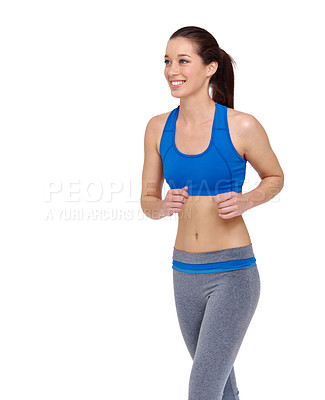 Buy stock photo A pretty young woman jogging while isolated on a white background