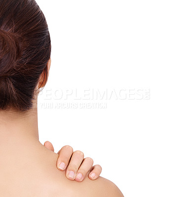 Buy stock photo A young woman touching her shoulder while isolated on a white background