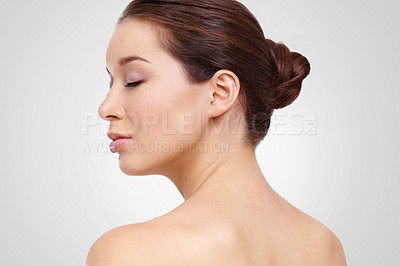 Buy stock photo Profile of a young woman with perfect skin against a white background with her eyes closed