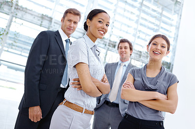 Buy stock photo Low angle view of a group of young businesspeople