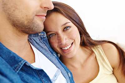Buy stock photo Close up of a pretty happy woman resting her head on her boyfriend's chest