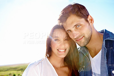Buy stock photo Portrait of an affectionate young couple enjoying a day out in the sun
