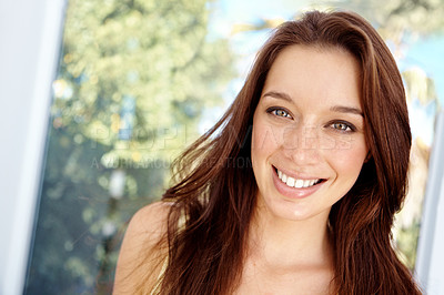 Buy stock photo Pretty young woman looking at the camera and smiling