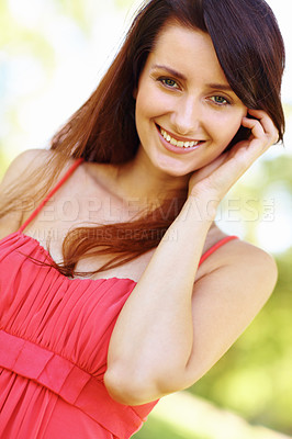 Buy stock photo Portrait of a shy smiling pretty brunette in the outdoors
