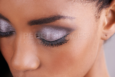 Buy stock photo Cropped shot of an attractive and elegant young woman wearing silver eyeshadow against a purple background