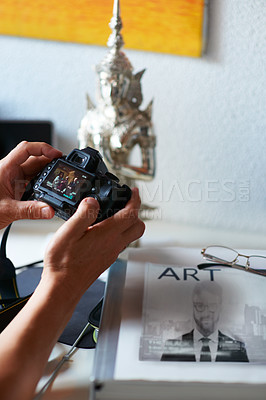 Buy stock photo Cropped shot of a man's hands holding a digital camera