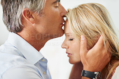 Buy stock photo Shot of a mature couple sharing a tender moment together at home