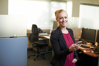 Buy stock photo Portrait of an attractive businesswoman using he cellphone in the office