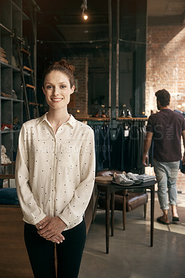 Buy stock photo A young woman in front of her clothing boutique