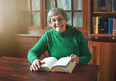 Buy stock photo Portrait of a smiling senior woman reading