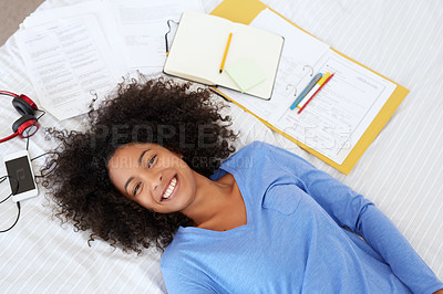 Buy stock photo Shot of a young woman relaxing on her bed