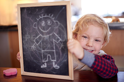 Buy stock photo Shot of a little boy showing you his drawing on a chalkboard