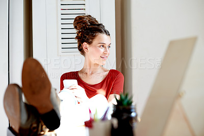Buy stock photo Shot of a teenage girl using her cellphone while relaxing at home