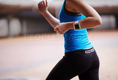 Buy stock photo Cropped shot of a young woman out running