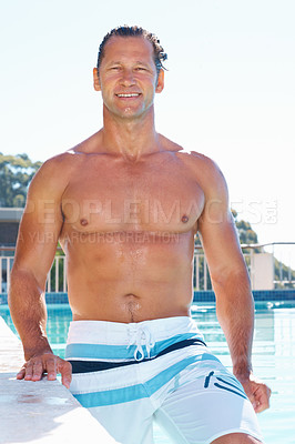 Buy stock photo Portrait of handsome mature man with a great body stepping out of the swimming pool