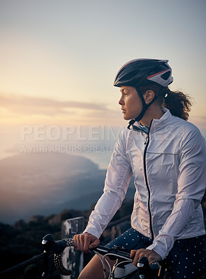 Buy stock photo Cropped shot of a young woman cycling in the mountains