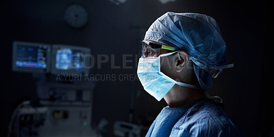Buy stock photo Shot of a surgeon in an operating room