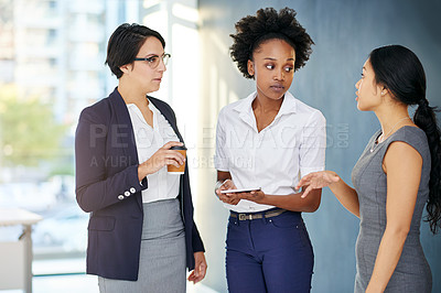 Buy stock photo Cropped shot of three businesswomen talking in the office