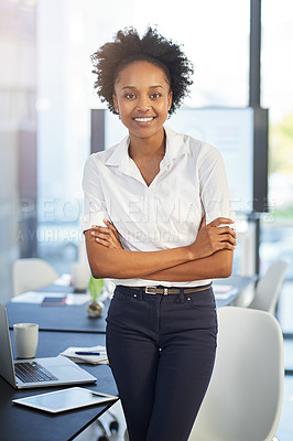 Buy stock photo Portrait of a confident young businesswoman standing in a modern office