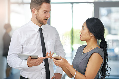 Buy stock photo Cropped shot of two colleagues meeting outside the boardroom before their presentation
