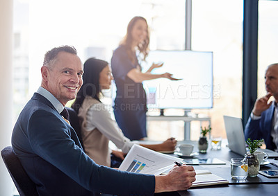 Buy stock photo Portrait of a businessman sitting in a boardroom presentation with colleagues
