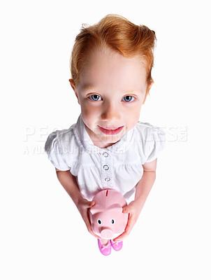 Buy stock photo Full length of an innocent redheaded girl holding piggybank isolated against white
