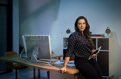 Buy stock photo Portrait of a young businesswoman standing at a desk in a modern office