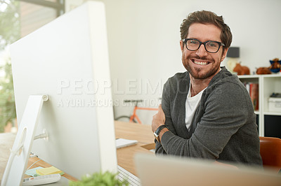 Buy stock photo Portrait of a young entrepreneur working at his desk