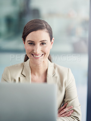 Buy stock photo Portrait of a professional businesswoman using a laptop at her office desk