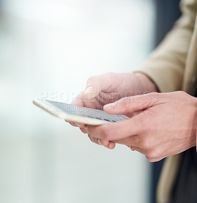 Buy stock photo Cropped shot of an unidentifiable businesswoman using her smartphone in the office