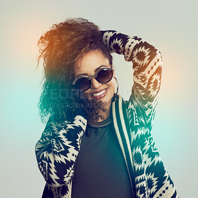 Buy stock photo Studio shot of a young woman posing with her hands in her hair