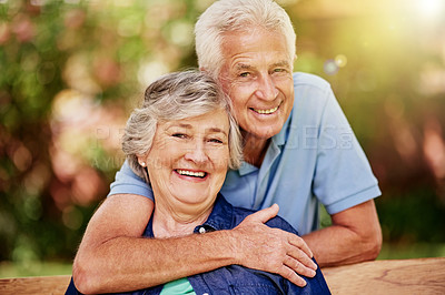 Buy stock photo Cropped portrait of an affectionate senior couple in their backyard